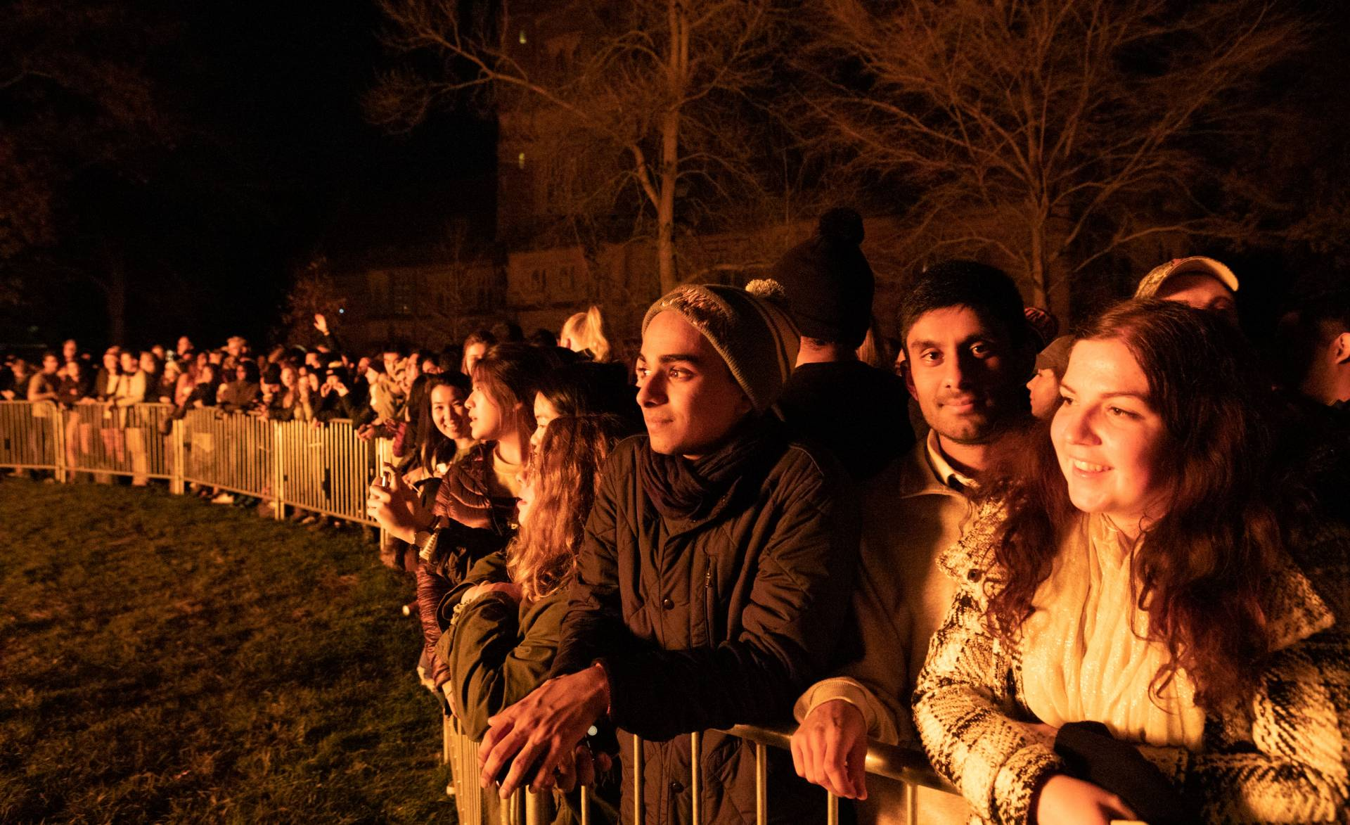 Students looking on at the bonfire