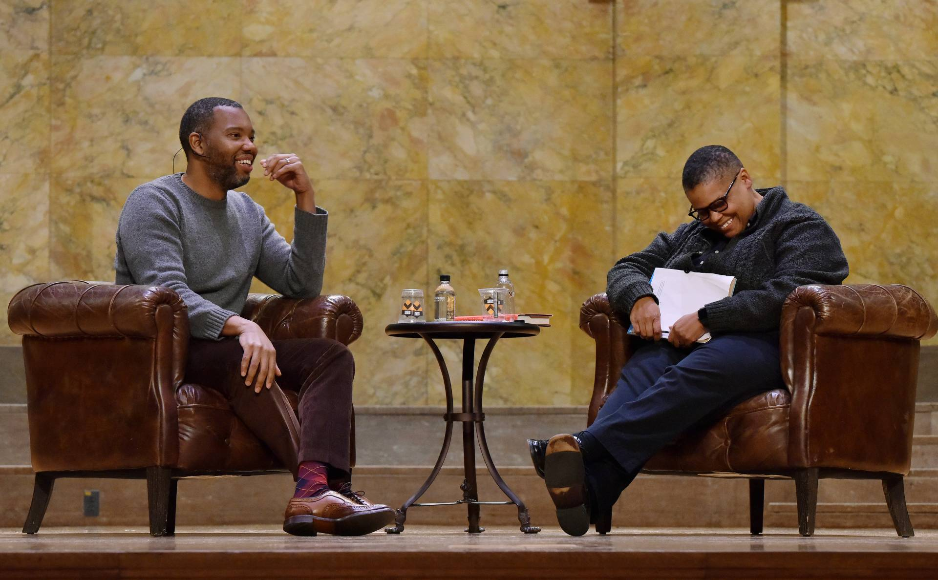 Ta-Nehisi Coates (left) and Keeanga-Yamahtta Taylor share a joke onstage during Coates' lecture