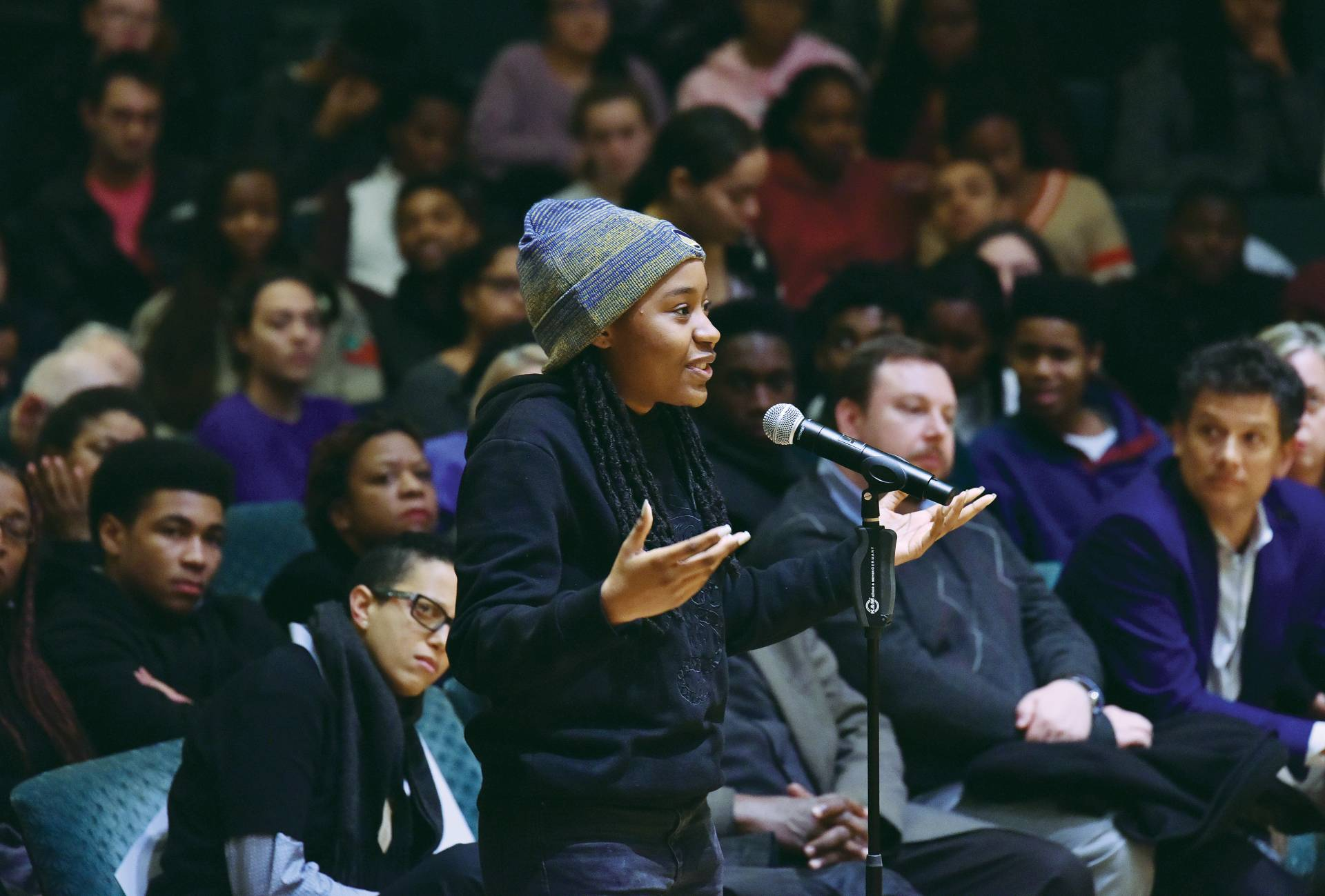 A students poses a question to Ta-Nehisi Coates