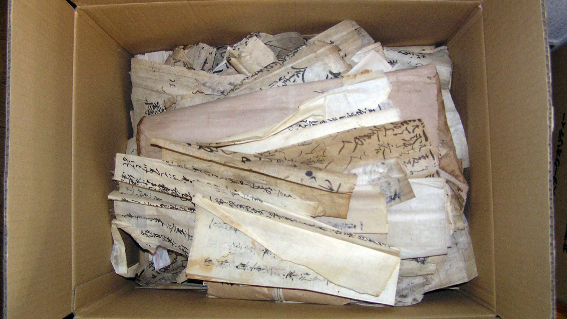 Cardboard box full of Japanese medieval documents