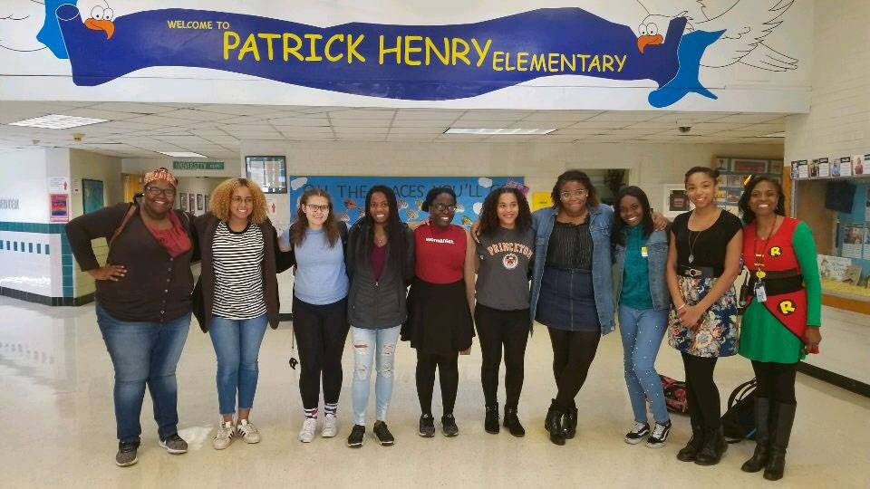 Students standing under banner for Patrick Henry Elementary School