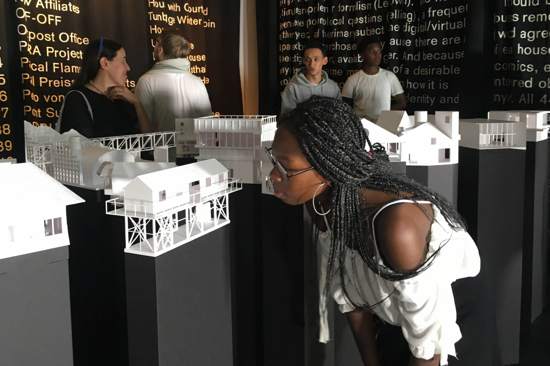 Students look around the Architecture exhibit with Dean Mónica Ponce de León