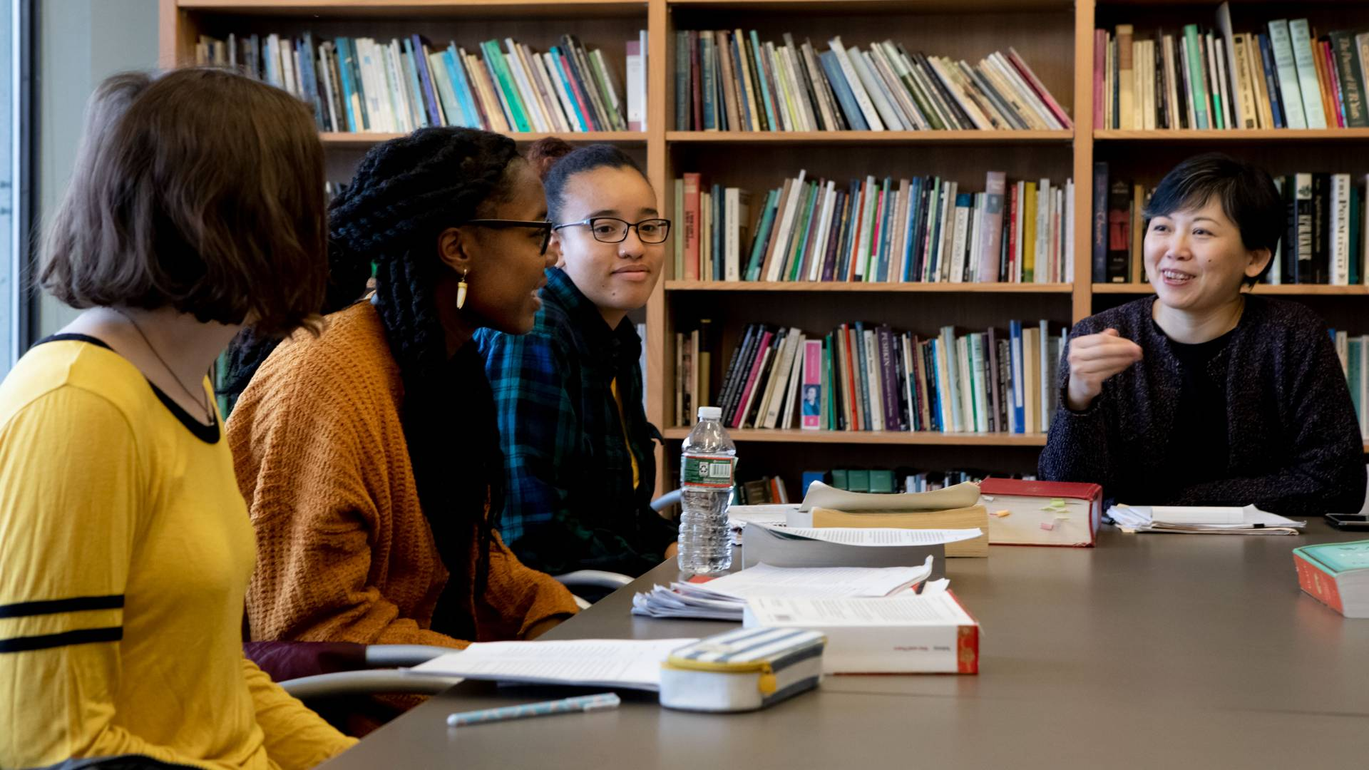 Yiyun Li engaging with three students in creative writing class