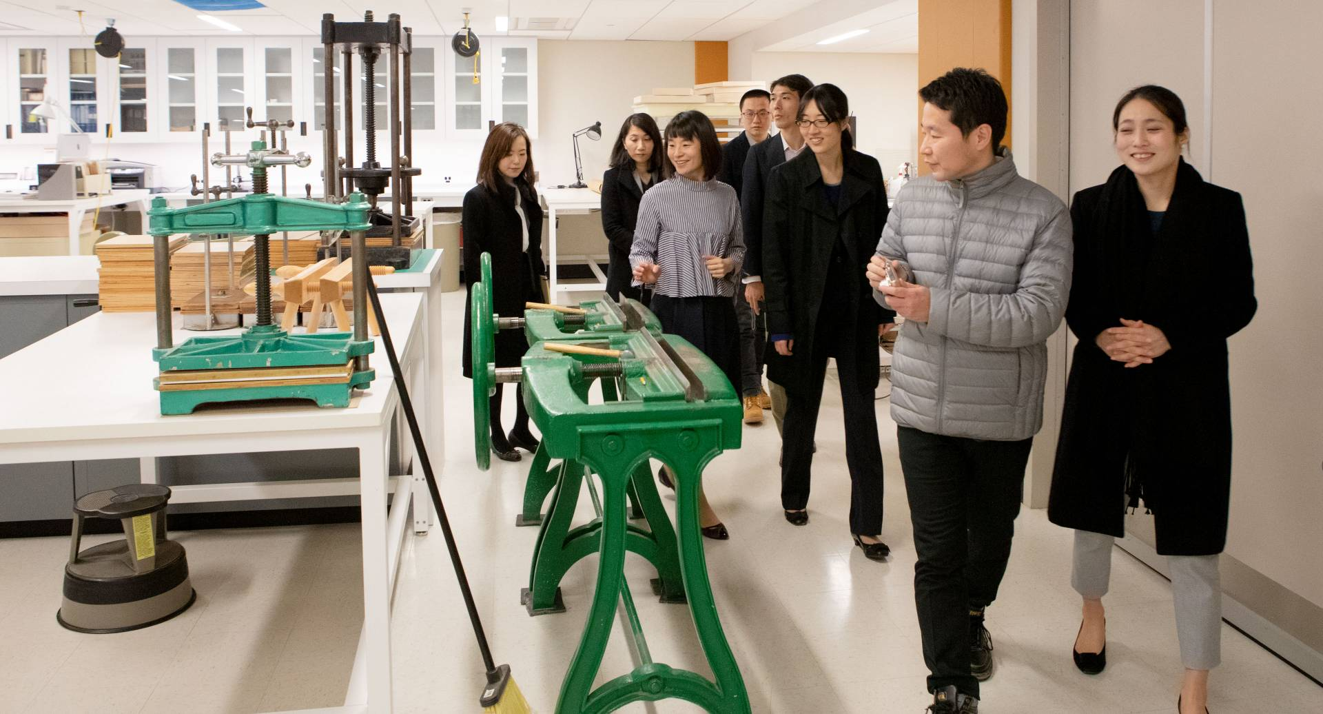 University of Tokyo delegates looking at machines in library