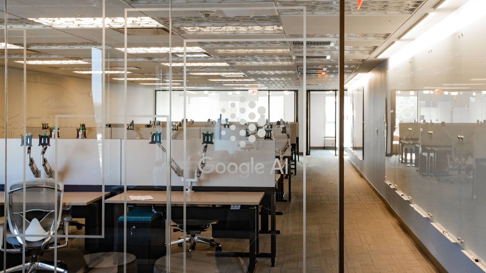 "Office space with ""Google AI"" etched on glass door"