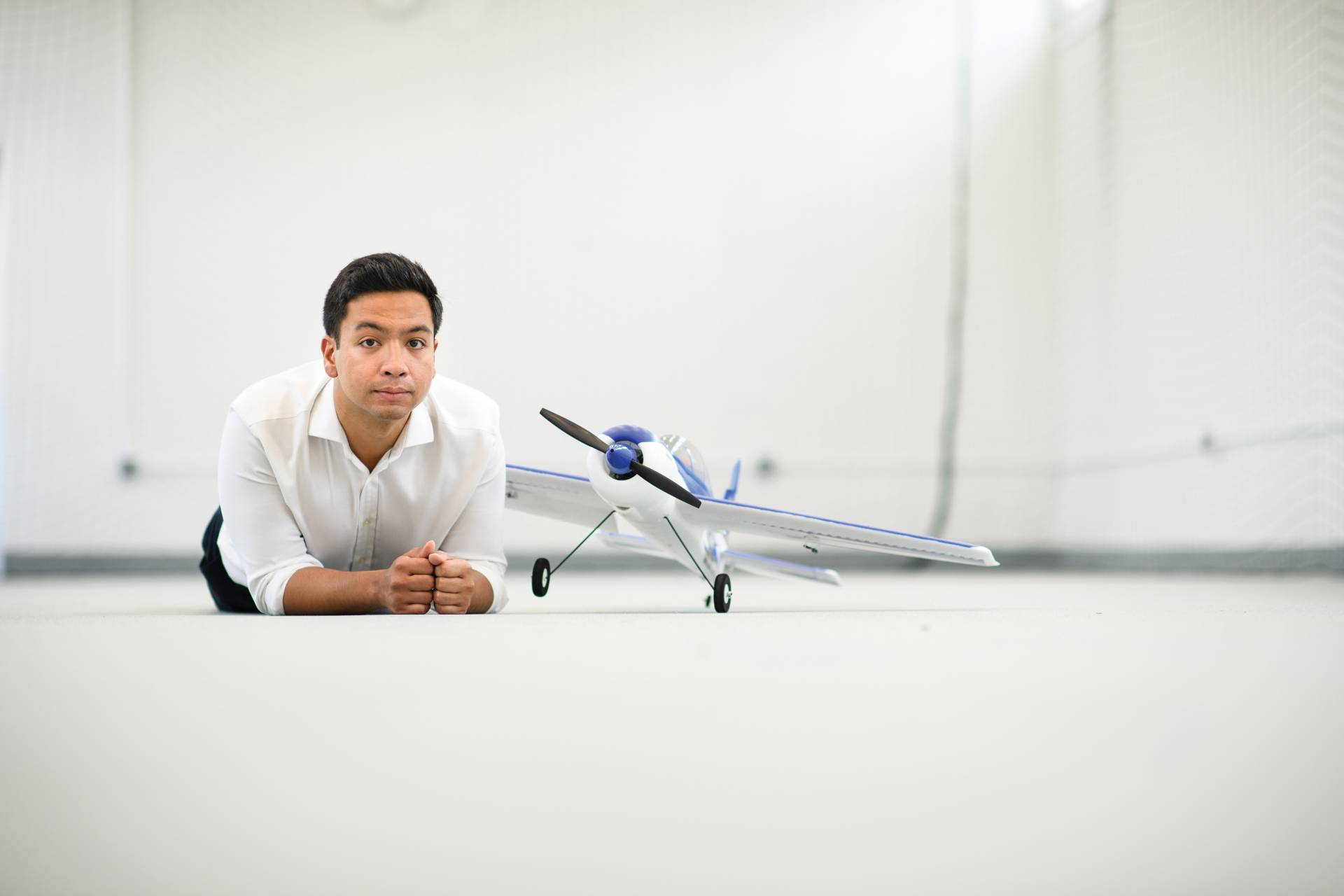 Anirudha Majumdar with a drone airplane