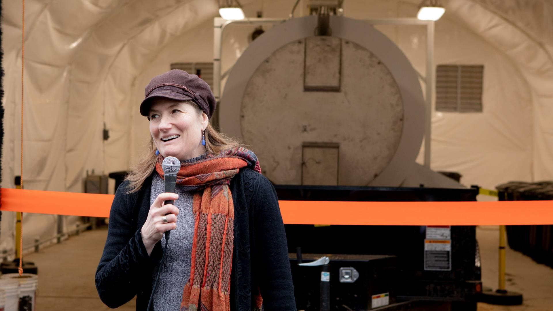 Shana Weber in front of biodigester