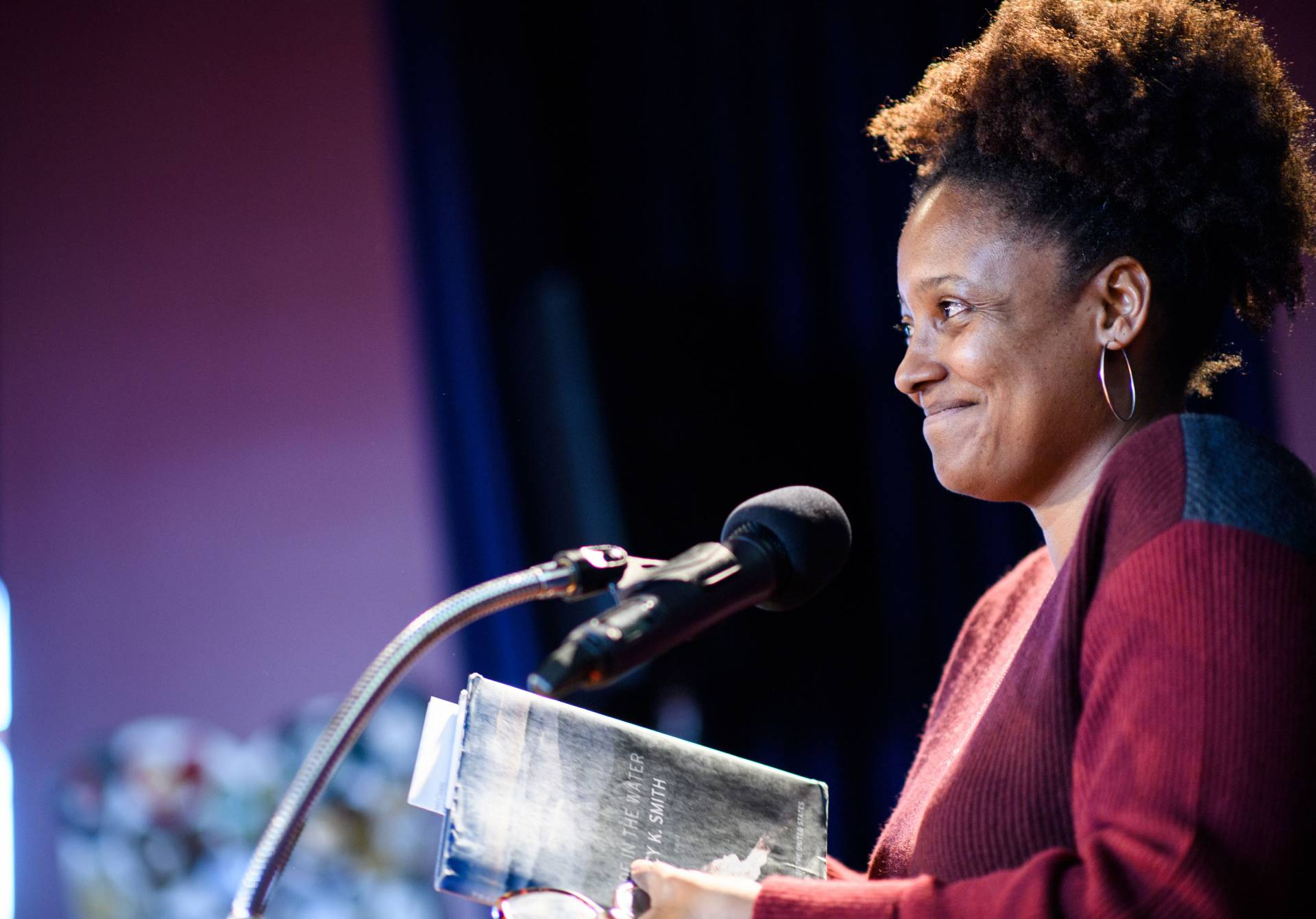 Tracy K. Smith speaking at podium