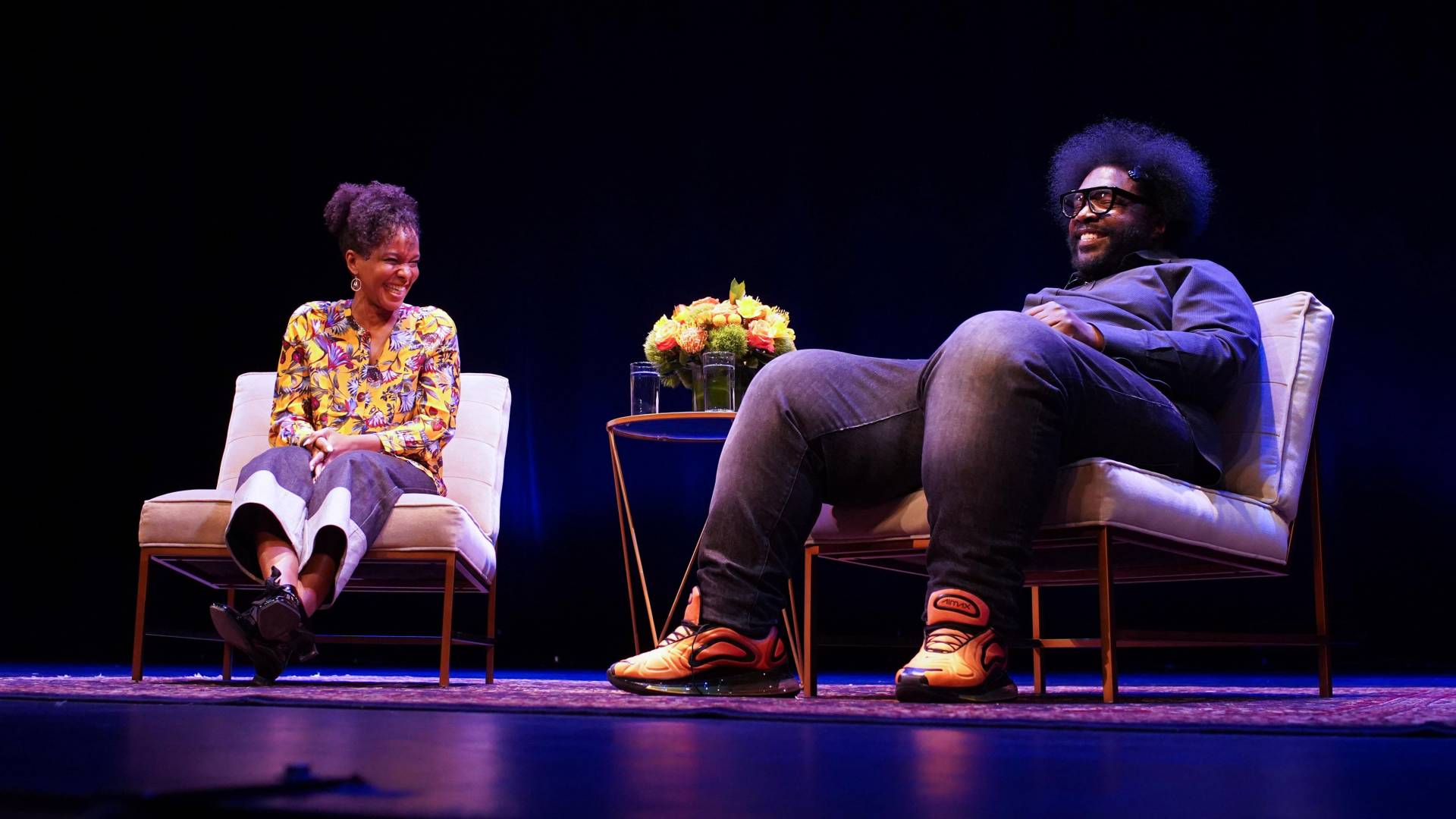 Imani Perry and Questlove speaking with each other on stage