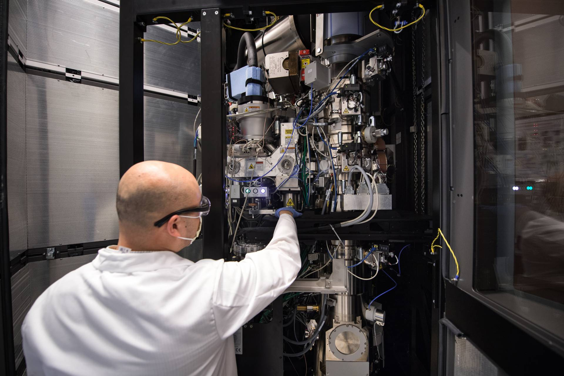 Paul Shao, imaging and analysis specialist, adjusts Princeton's cryo-electron microscope