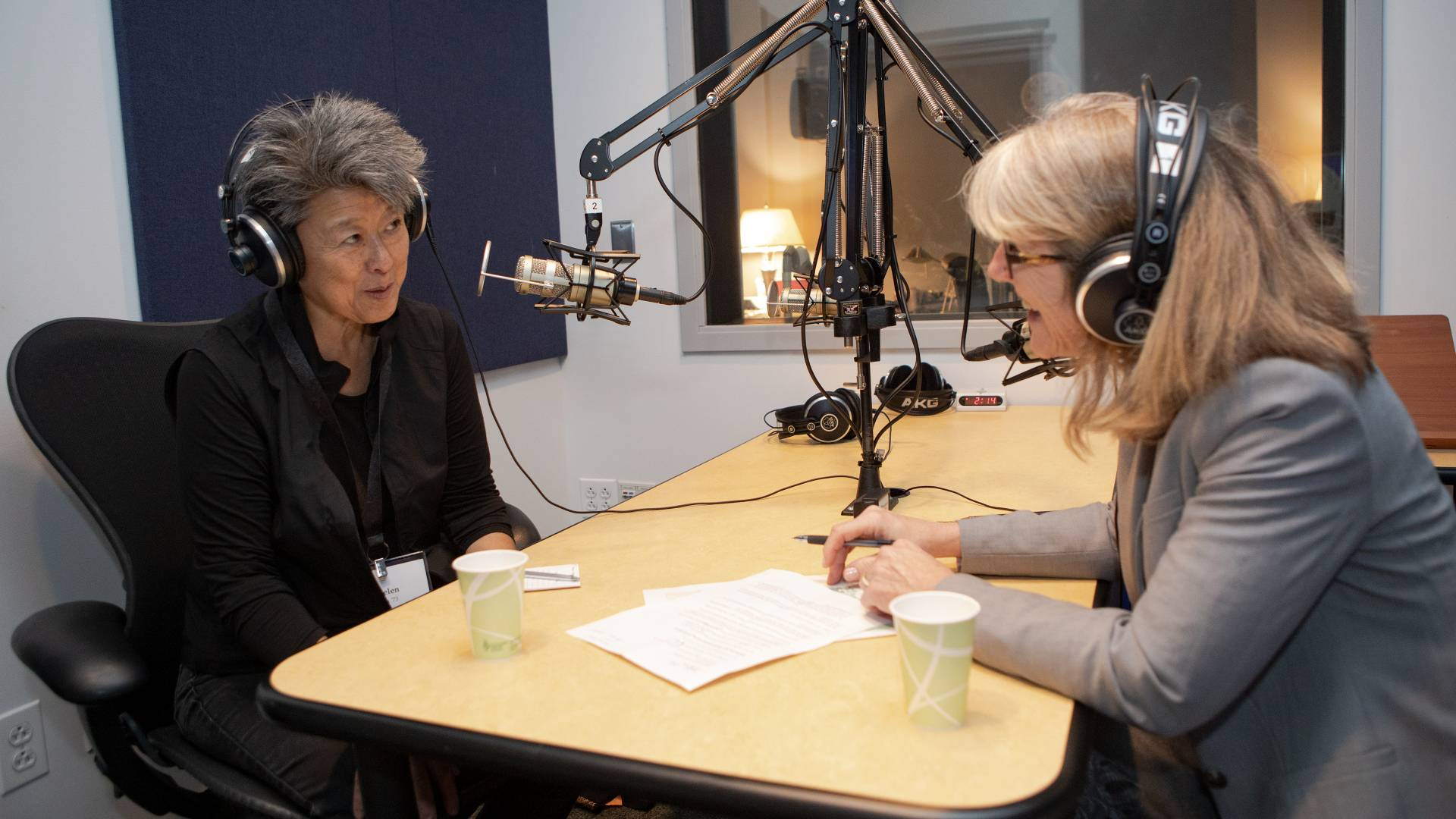 Helen Zia recording podcast with Margaret Koval