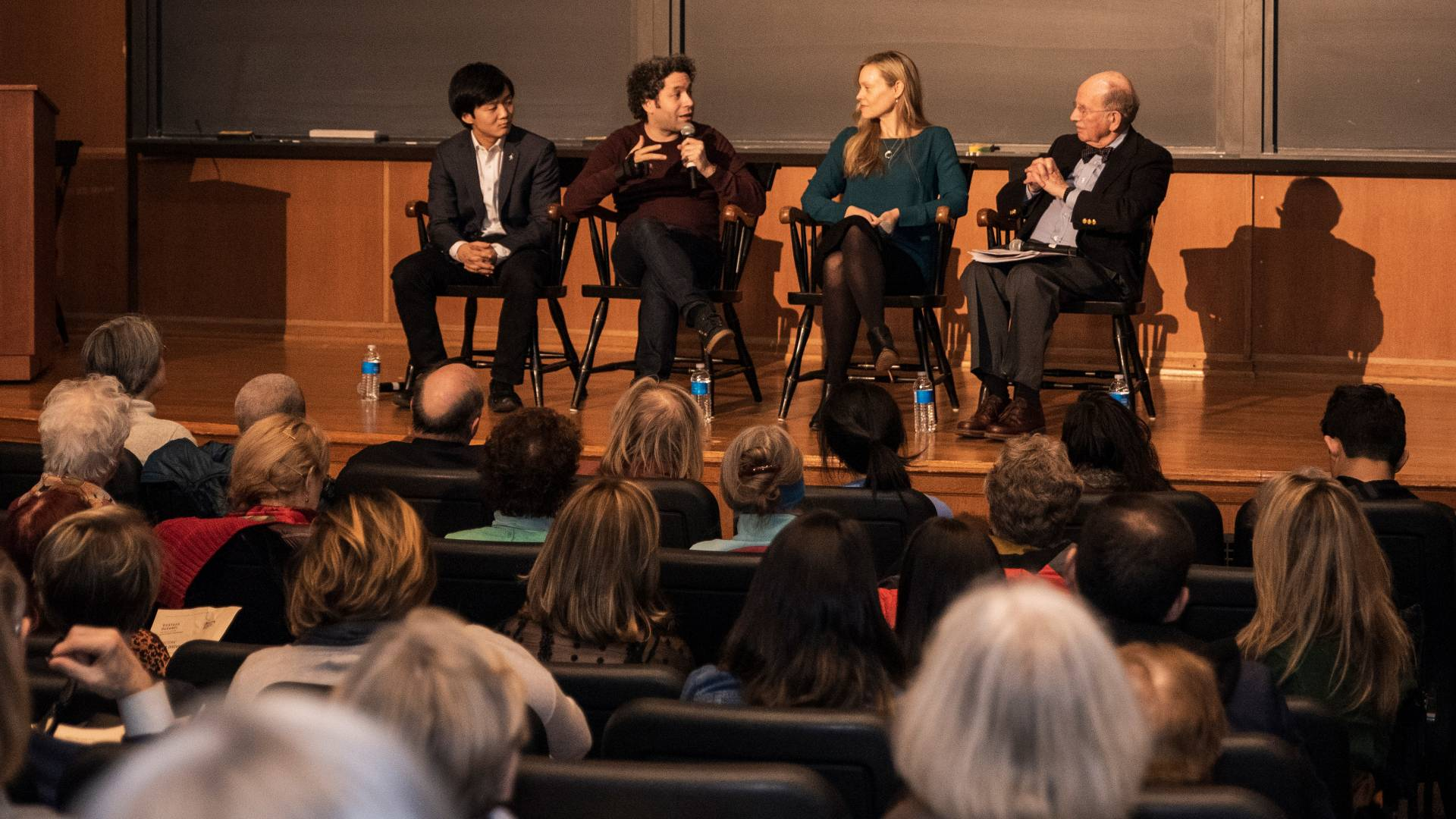 Lou Chen, Gustavo Dudamel, Anne Fitzgibbon, Stanley Katz sitting on stage during panel session