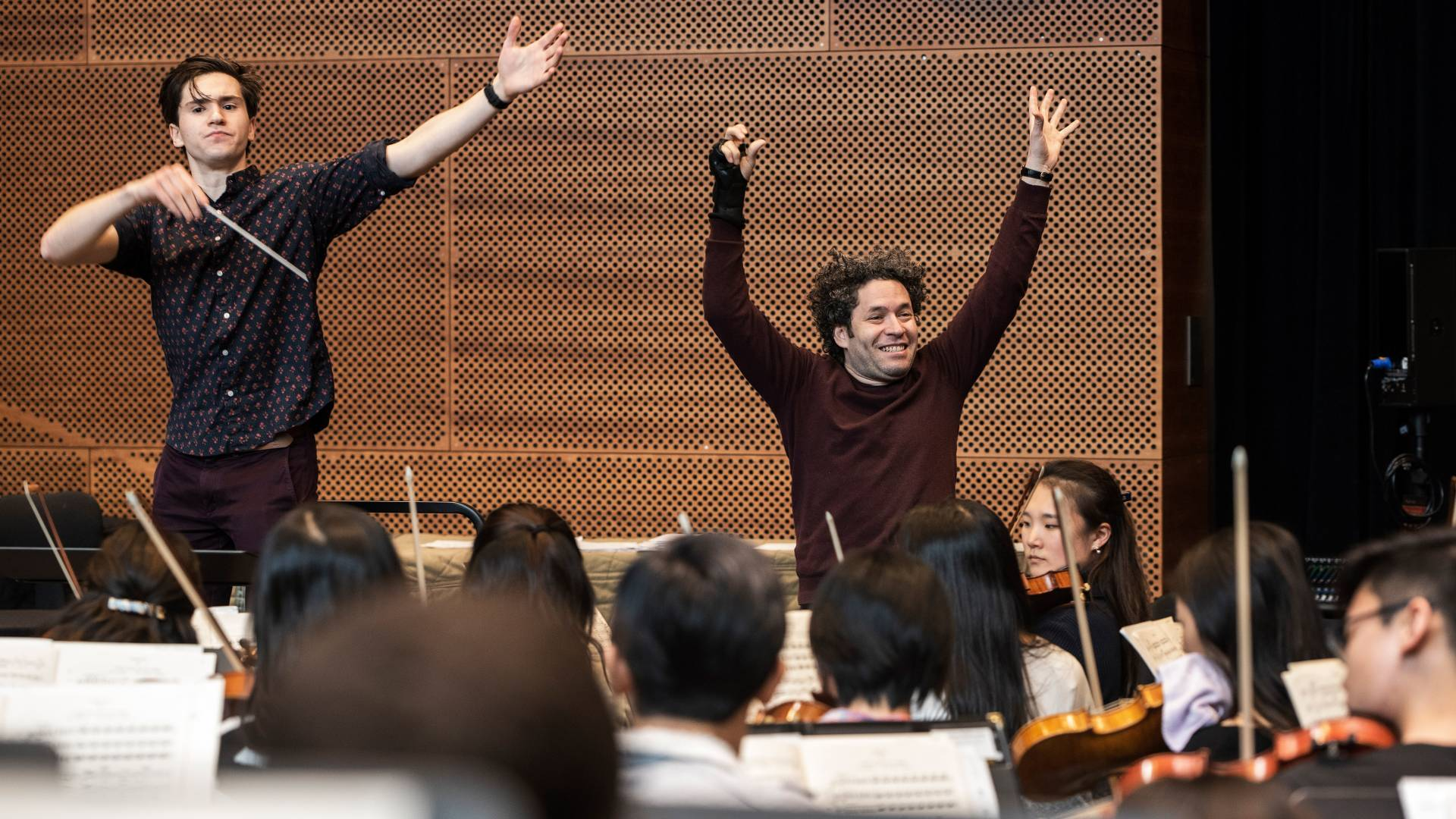 Reilly Bova and Gustavo Dudamel conducting orchestra