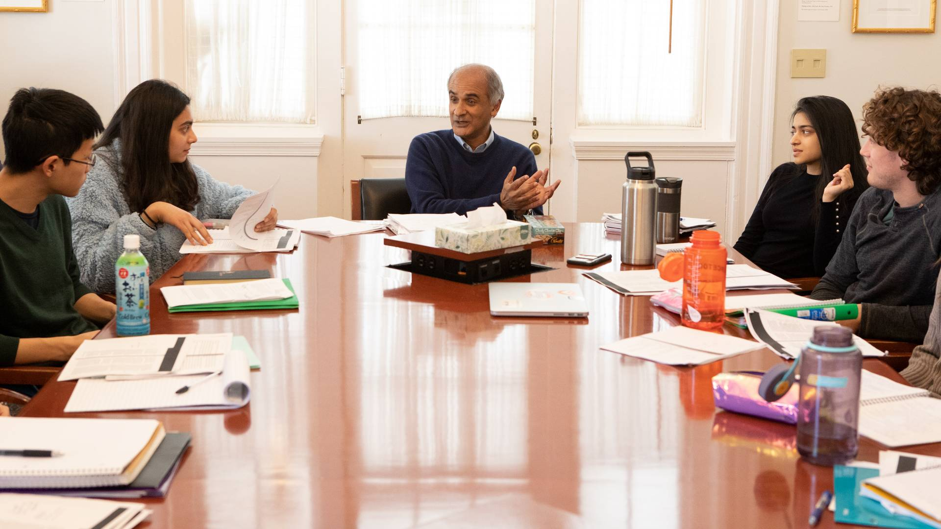 Pico Iyer and students sitting around table