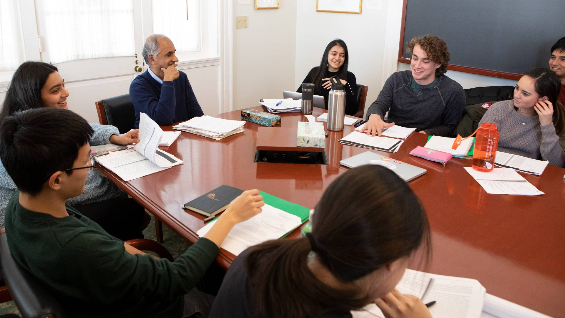 Pico Iyer listening to students during class