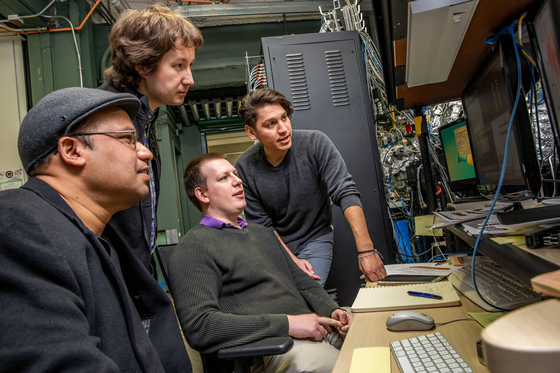 Zahid Hasan and his research team gathered around a computer
