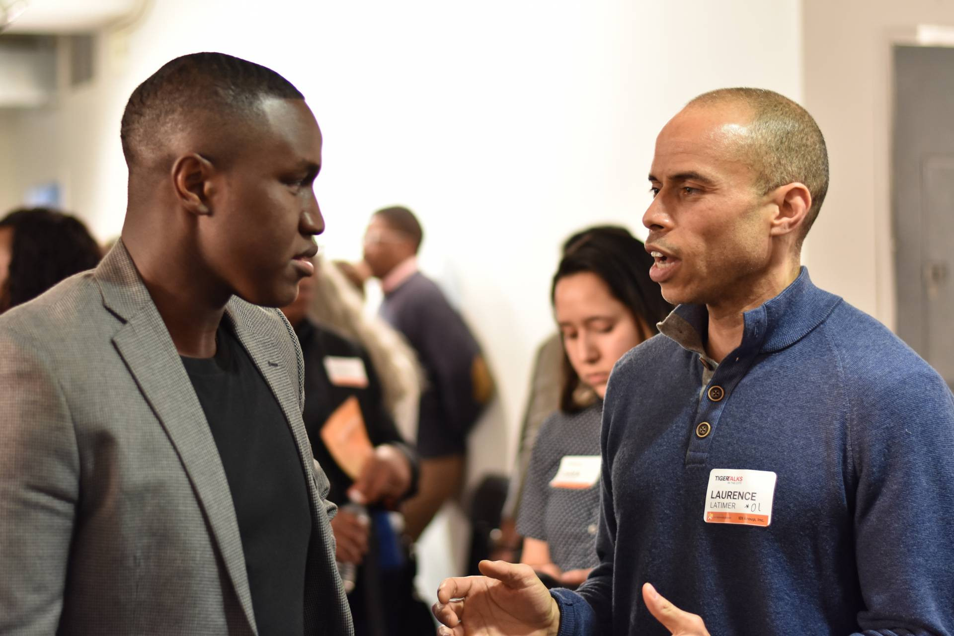 Two men have a conversation at the Tiger Talks conference