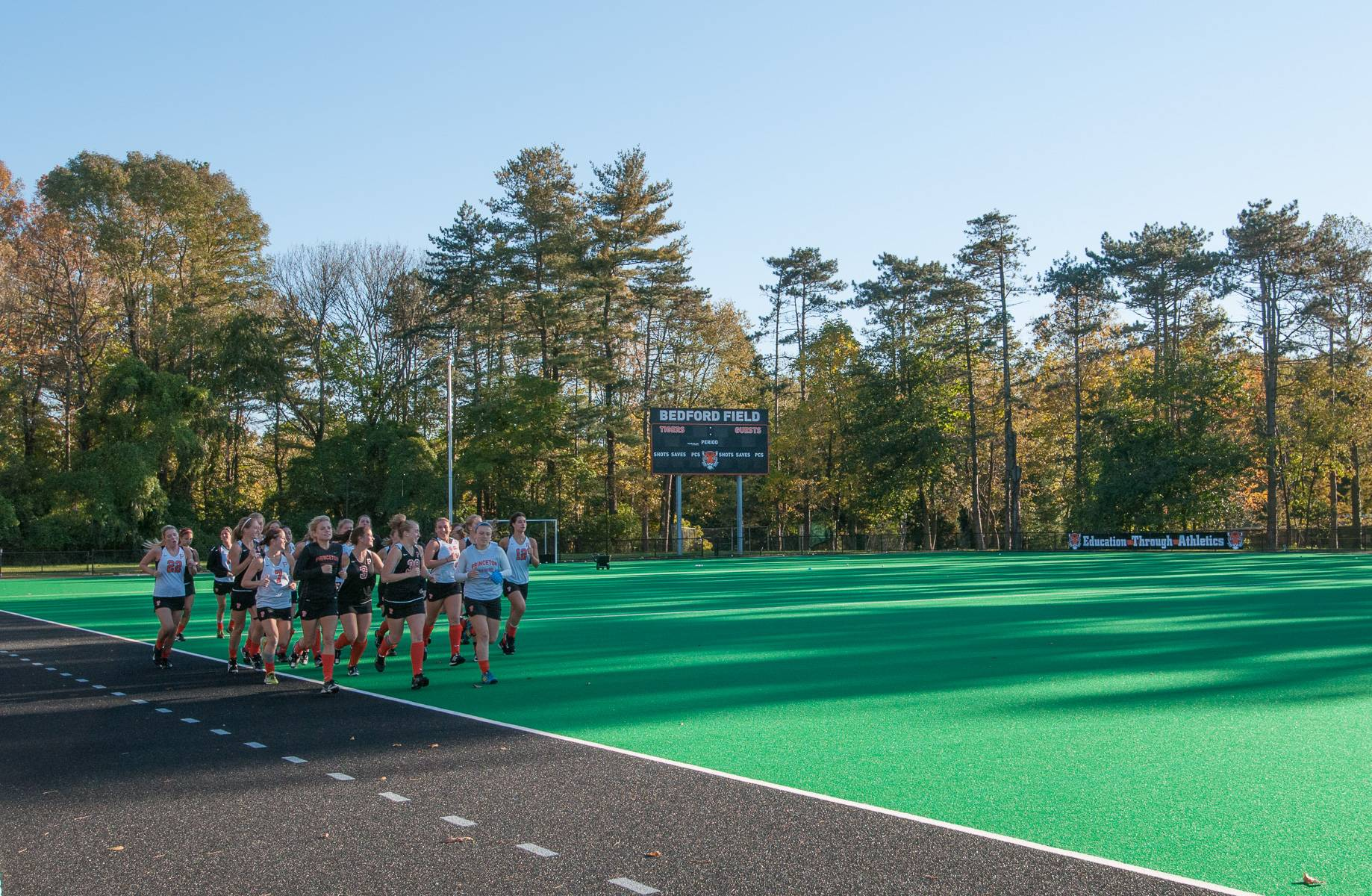Students running on Bedford Field