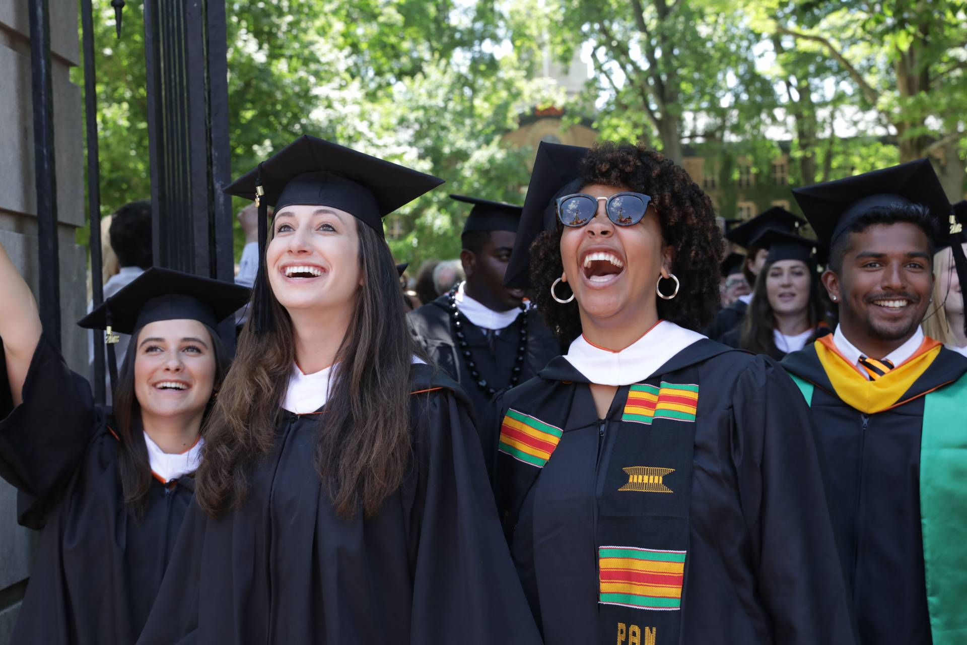 Joyful 2018 graduates stream out of Fitzrandolph Gate