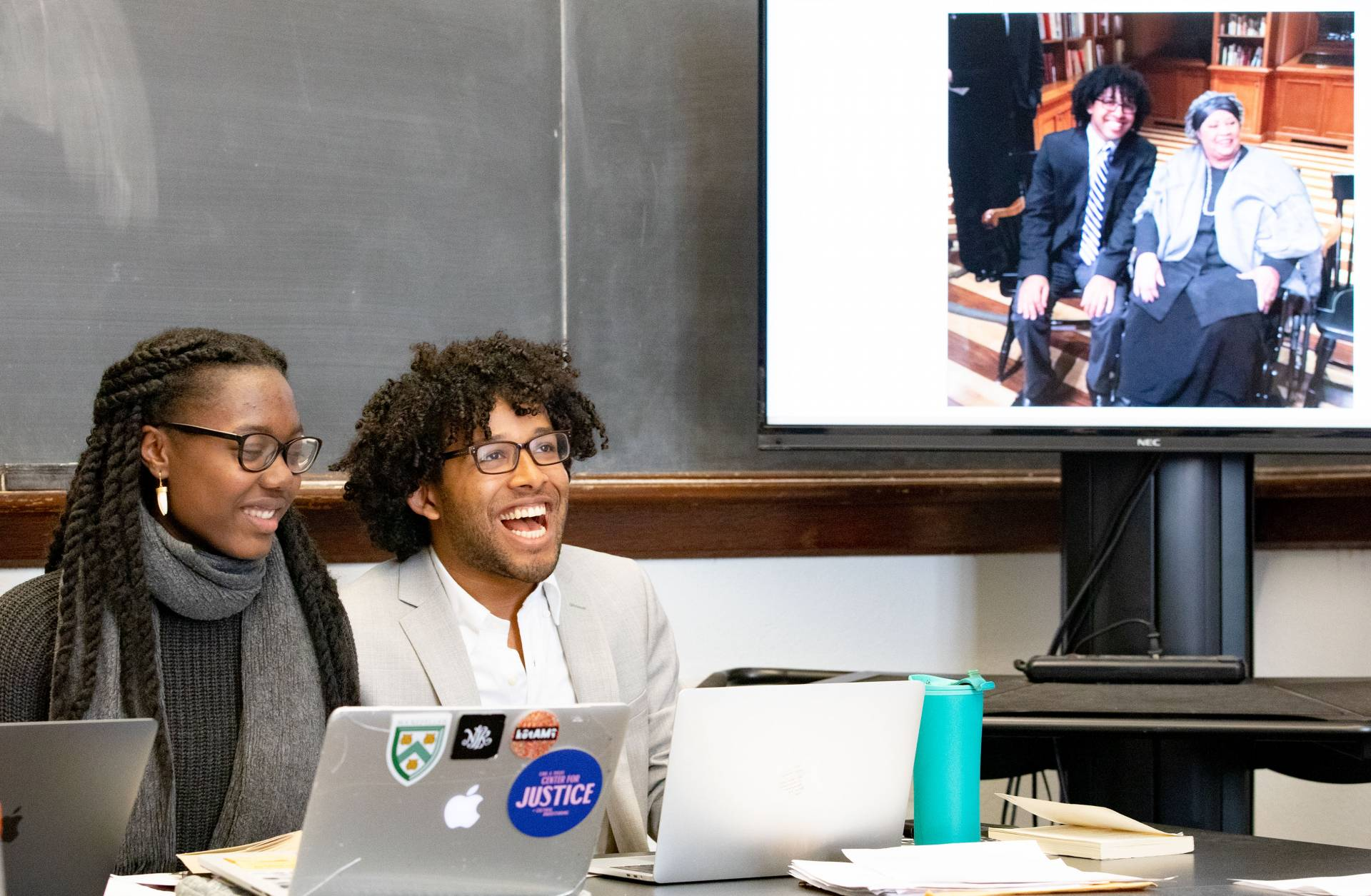Two students present a slide showing one of the students meeting Toni Morrison herself