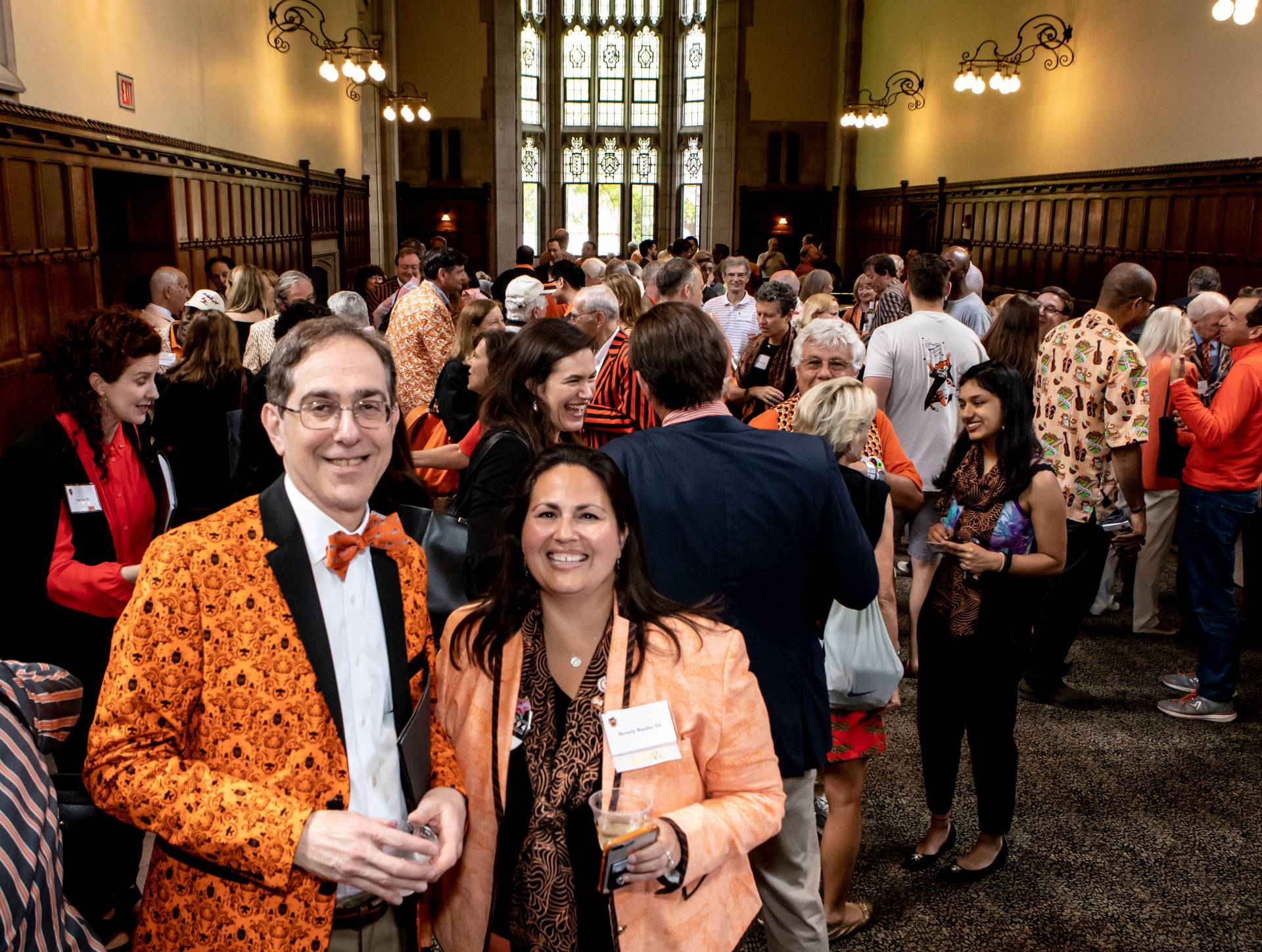 Christopher L. Eisgruber and Beverly Randez catch up at a Reunions reception
