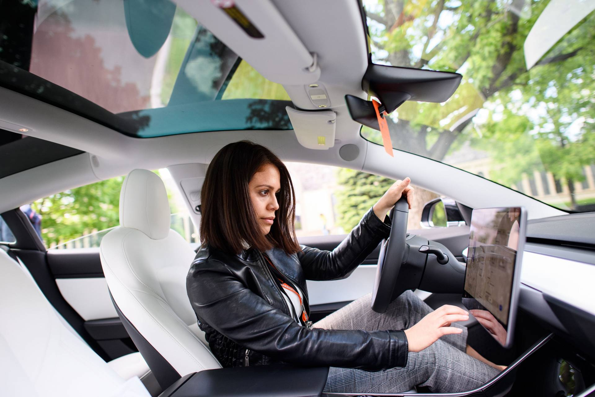 A woman sits in a Tesla