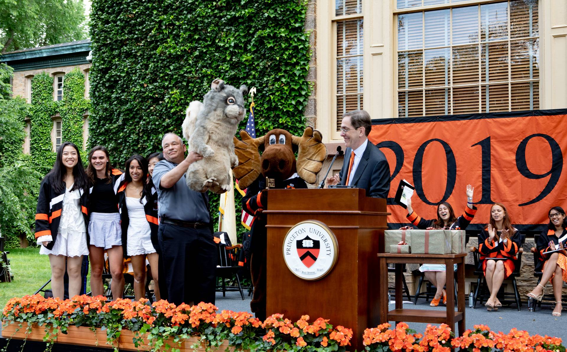 President Christopher L. Eisgruber presents a stuffed squirrel to the class