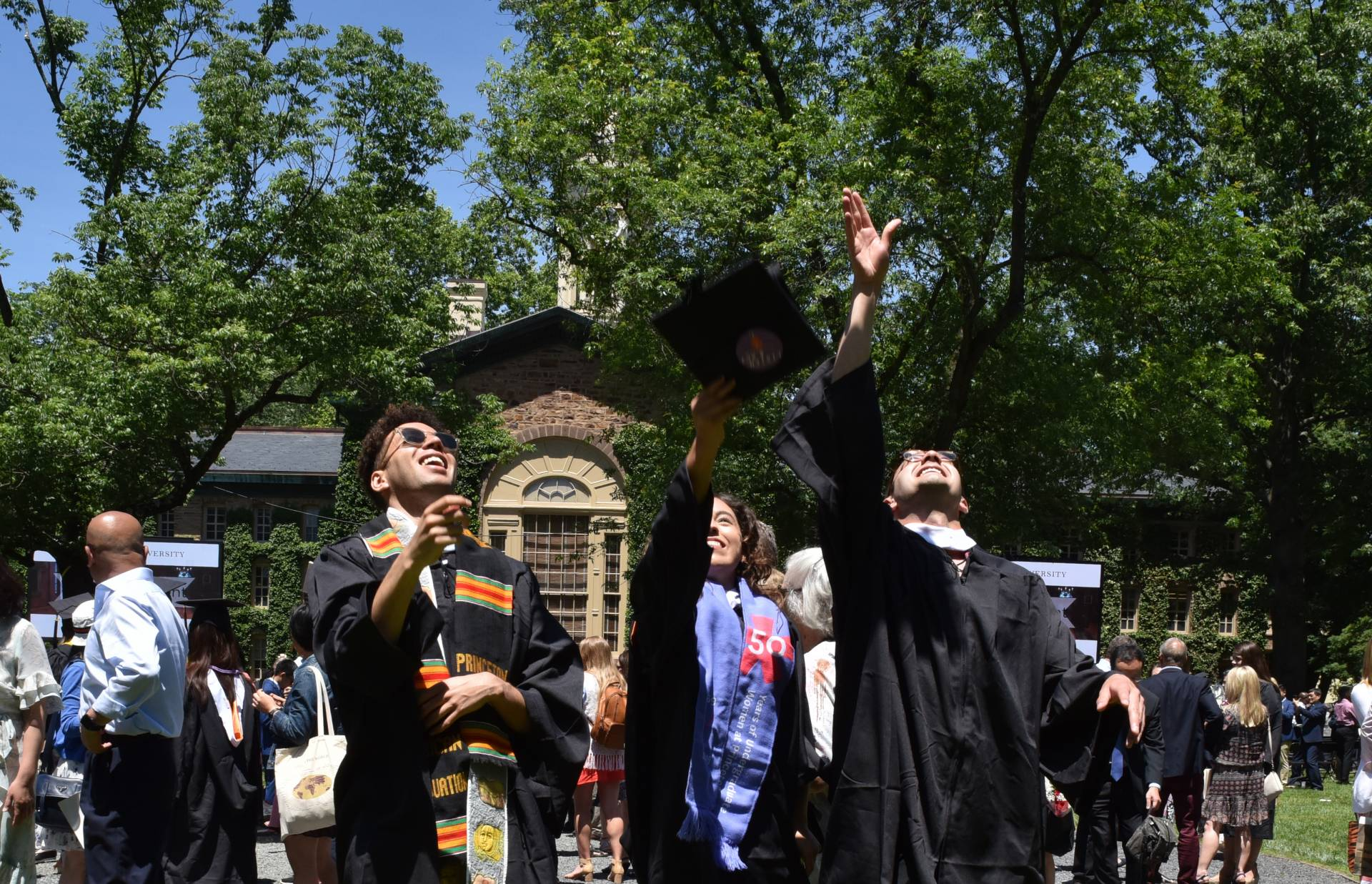 Graduates throw thier mortarboards into the air