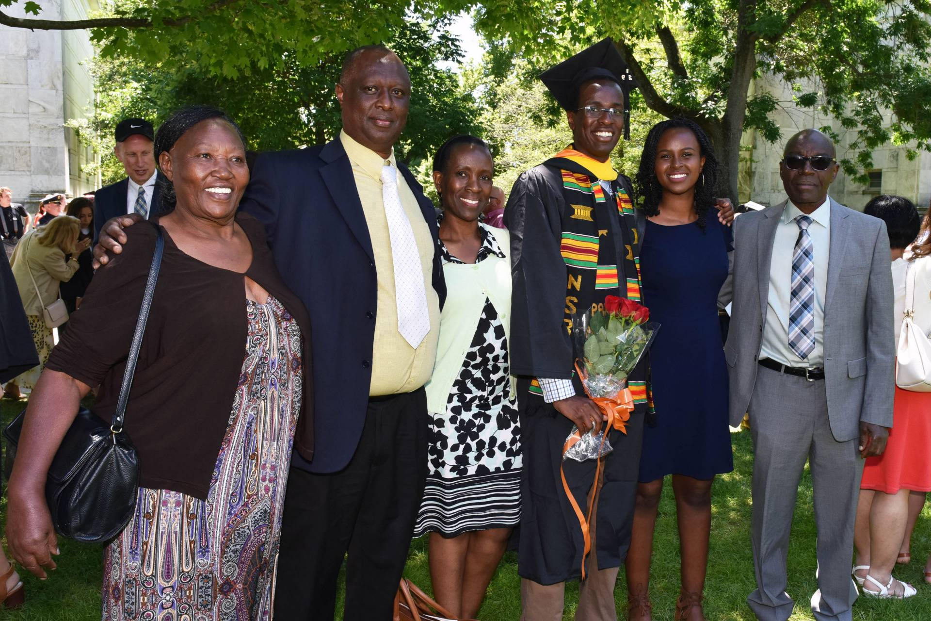 Njuguna Thande standing with family