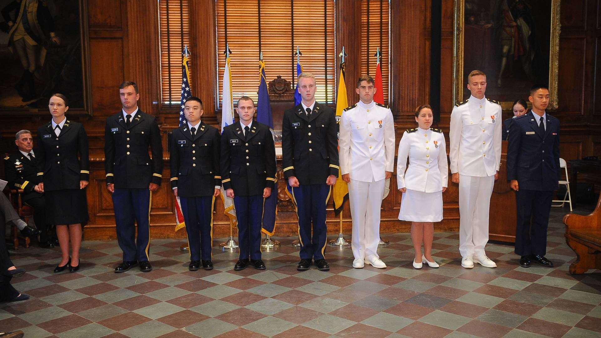 Graduates from Princeton's ROTC program stand together