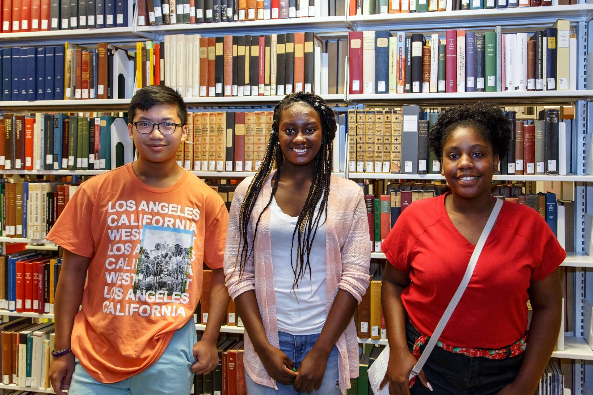 Three interns in the library