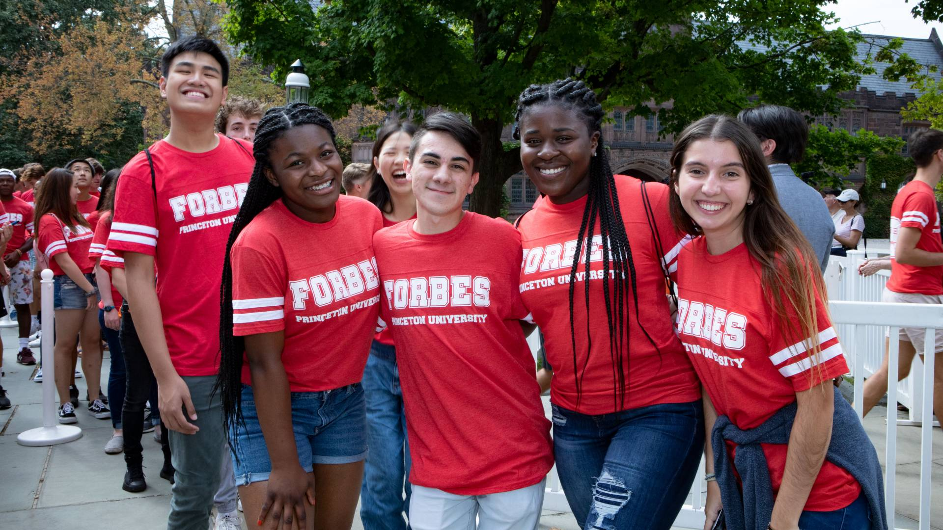 Students wearing Forbes t shirts pose for a photo
