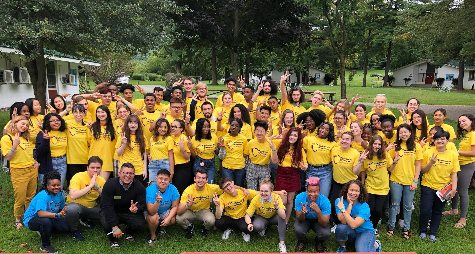 Group of students wearing yellow T-shirts