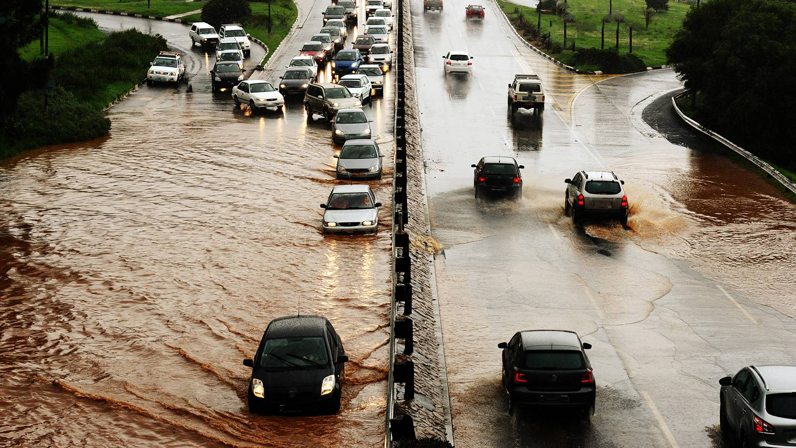 Cars driving through a flooded highway