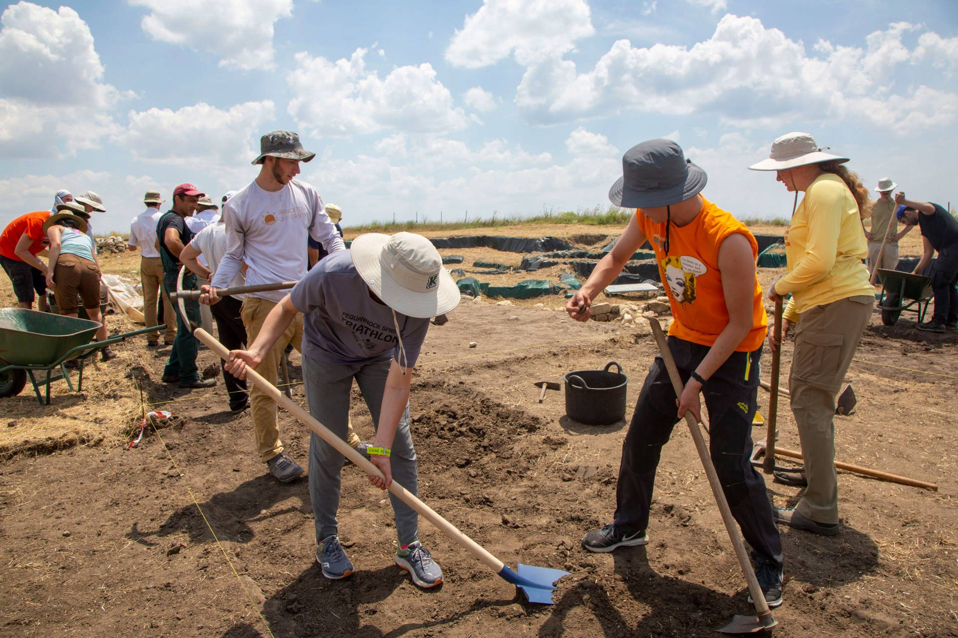 Students digging at site