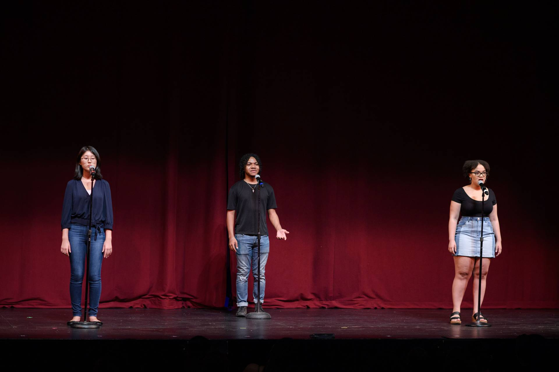 3 students perform in the student story slam ensemble