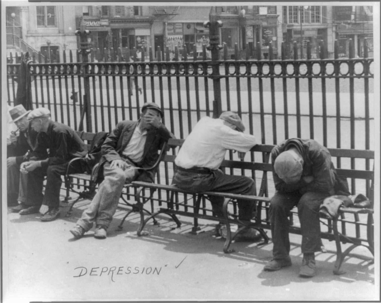 Men slumped over while seated on a bench