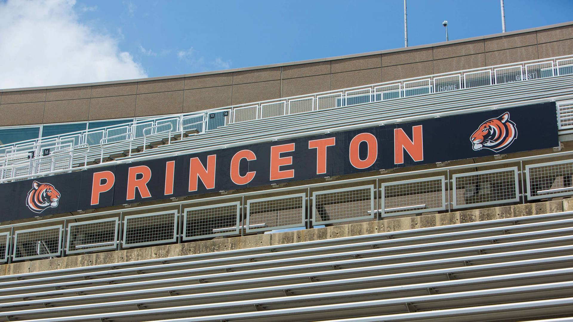 "banner that reads ""Princeton"" flanked by tiger head illustrations at Powers Field"