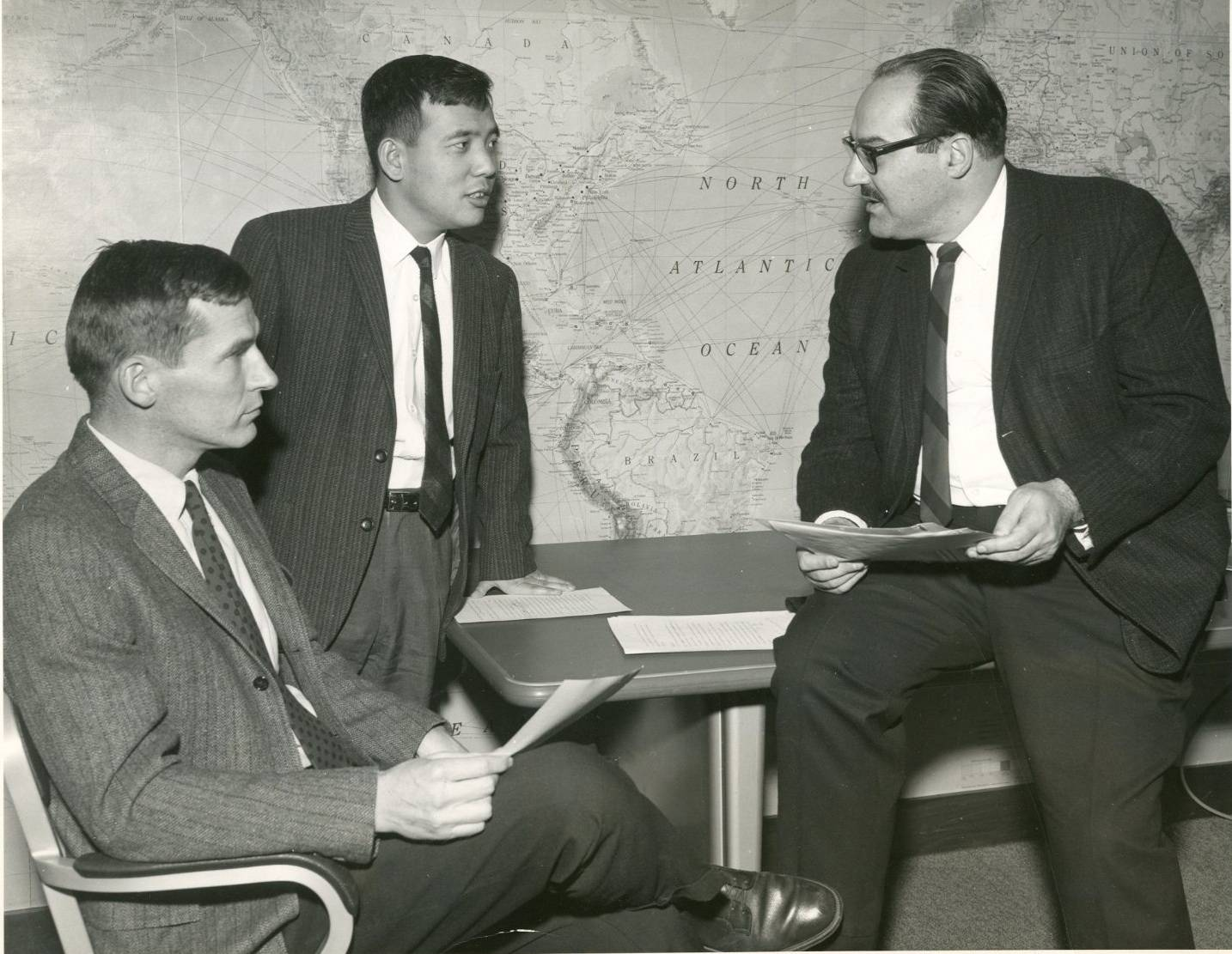 archival image of researchers meeting at the Geophysical Fluid Dynamics Laboratory