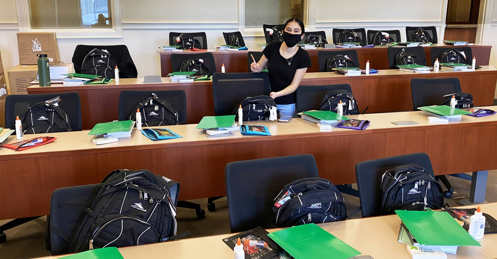 Summer teaching assistant for the Princeton University Preparatory Program, prepares backpacks filled with essential supplies for this year's cohort of PUPP scholars
