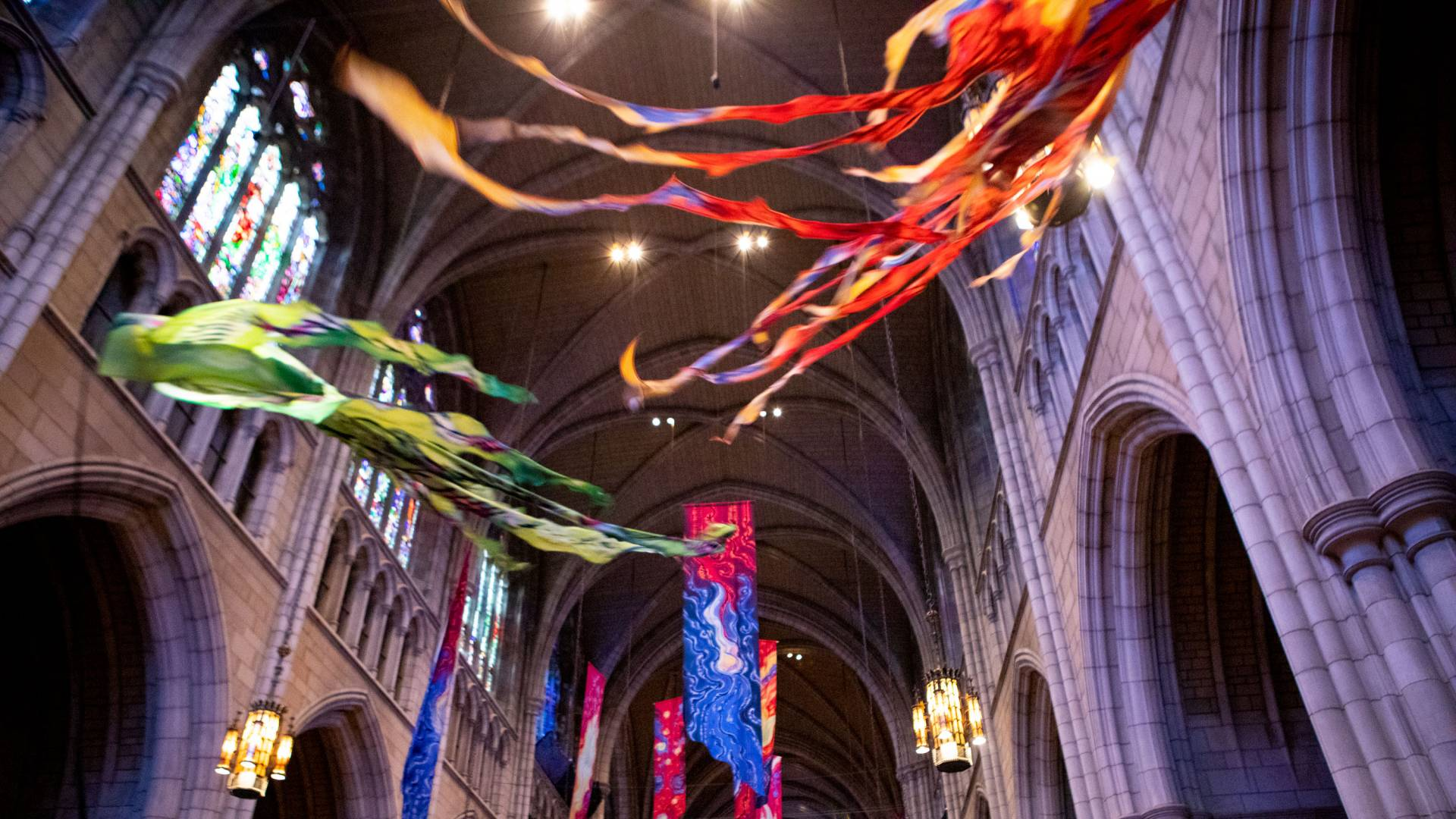 Kites fly in the University Chapel as a traditional part of Opening Exercises