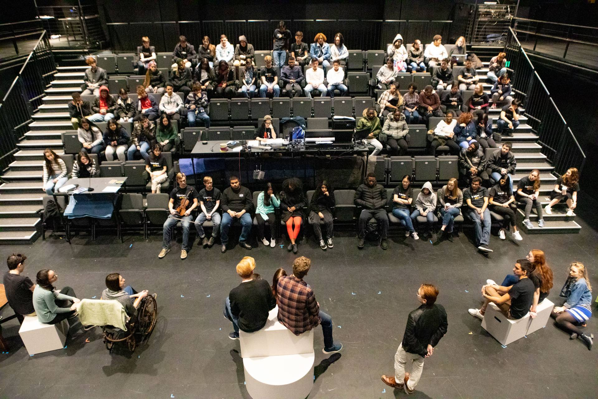 Students arrive for the morning in the Forum and watch a musical number of a Lewis Center student theater production and ask questions in the Wallace Theater