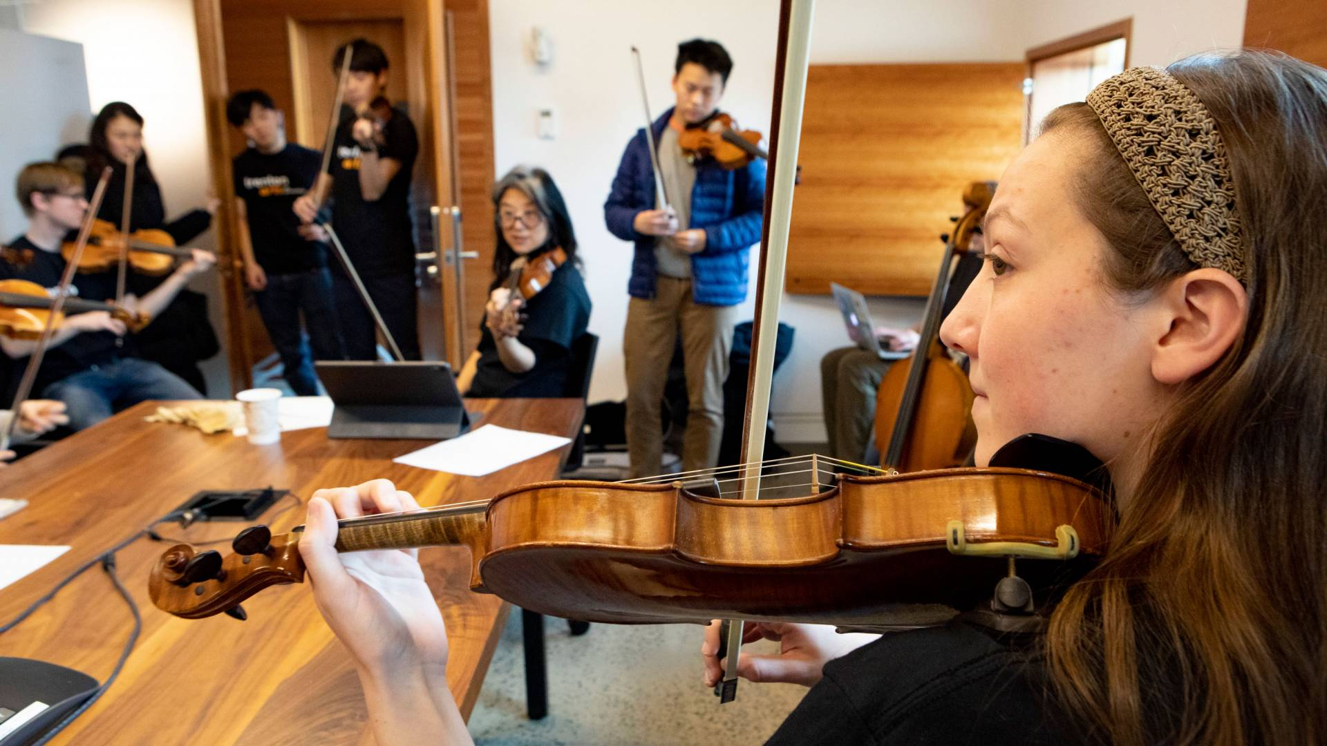 Anna Lim leads a strings lesson