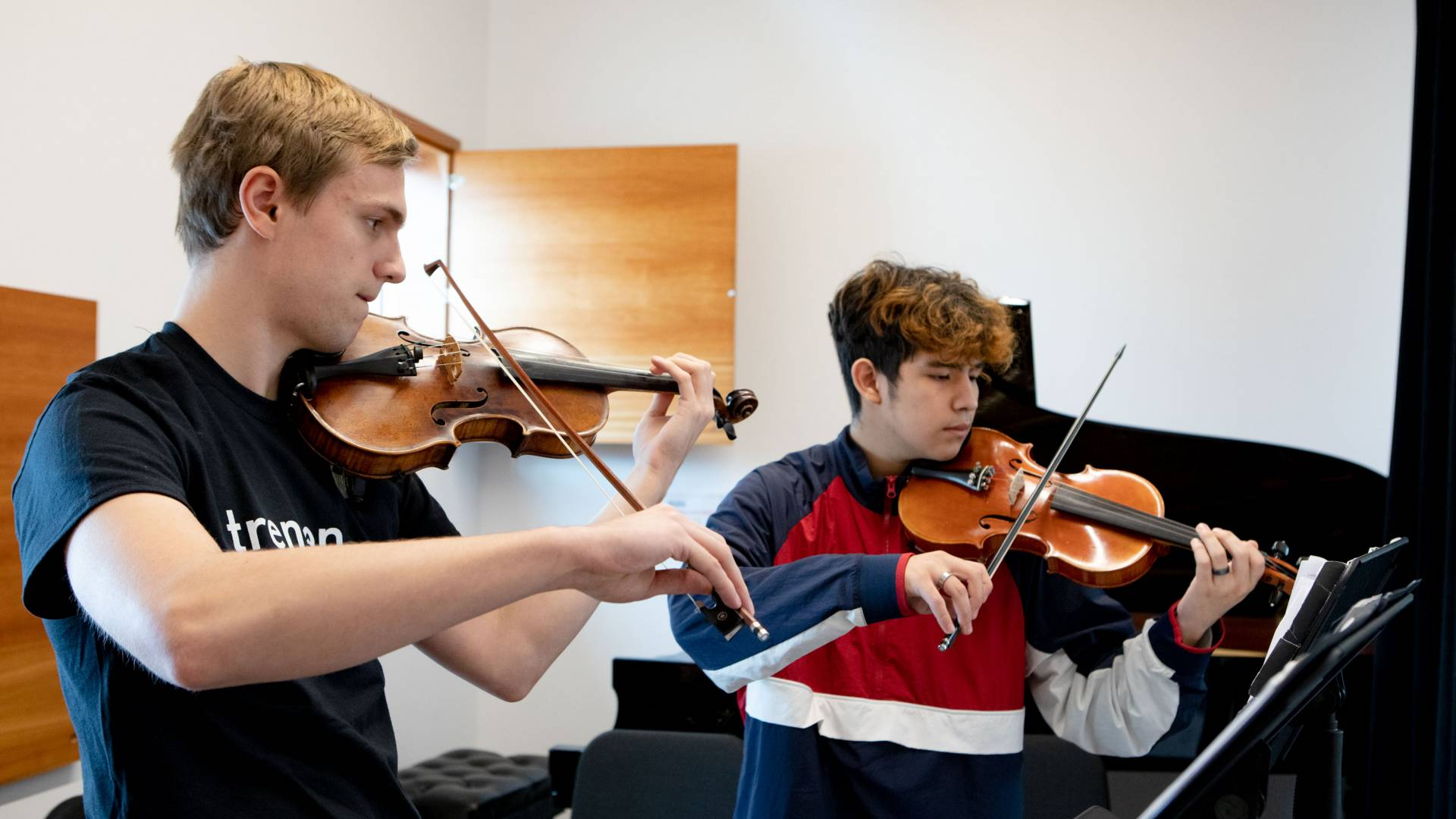 Nick Schmeller '21 and Trenton student Michael Martinez having a private violin lesson