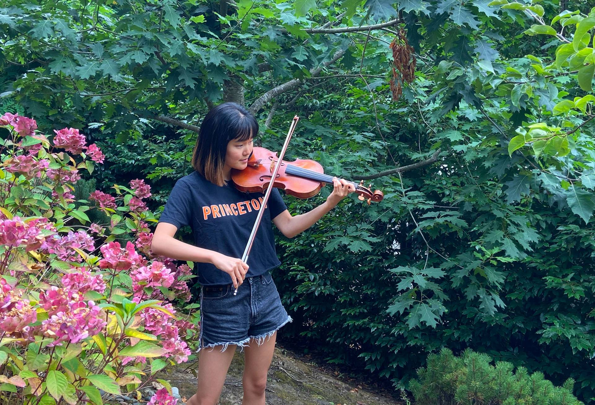 Cammie Lee practicing violin her yard in Portland, Oregon