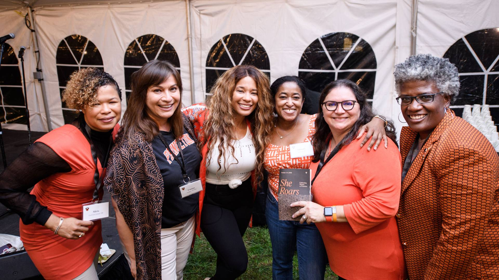 Kwanza Jones and sister Meta DuEwa Jones pose with attendees of She Roars