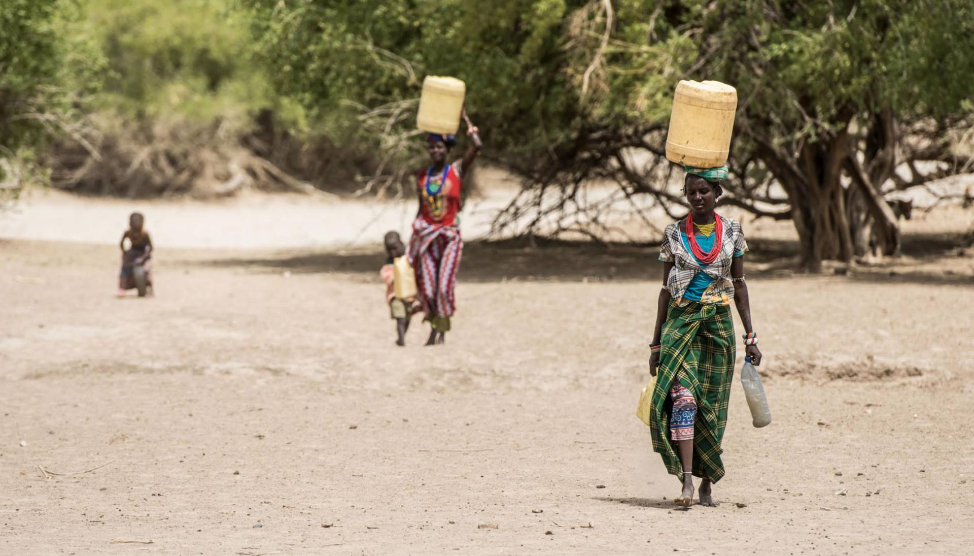 women carrying containers