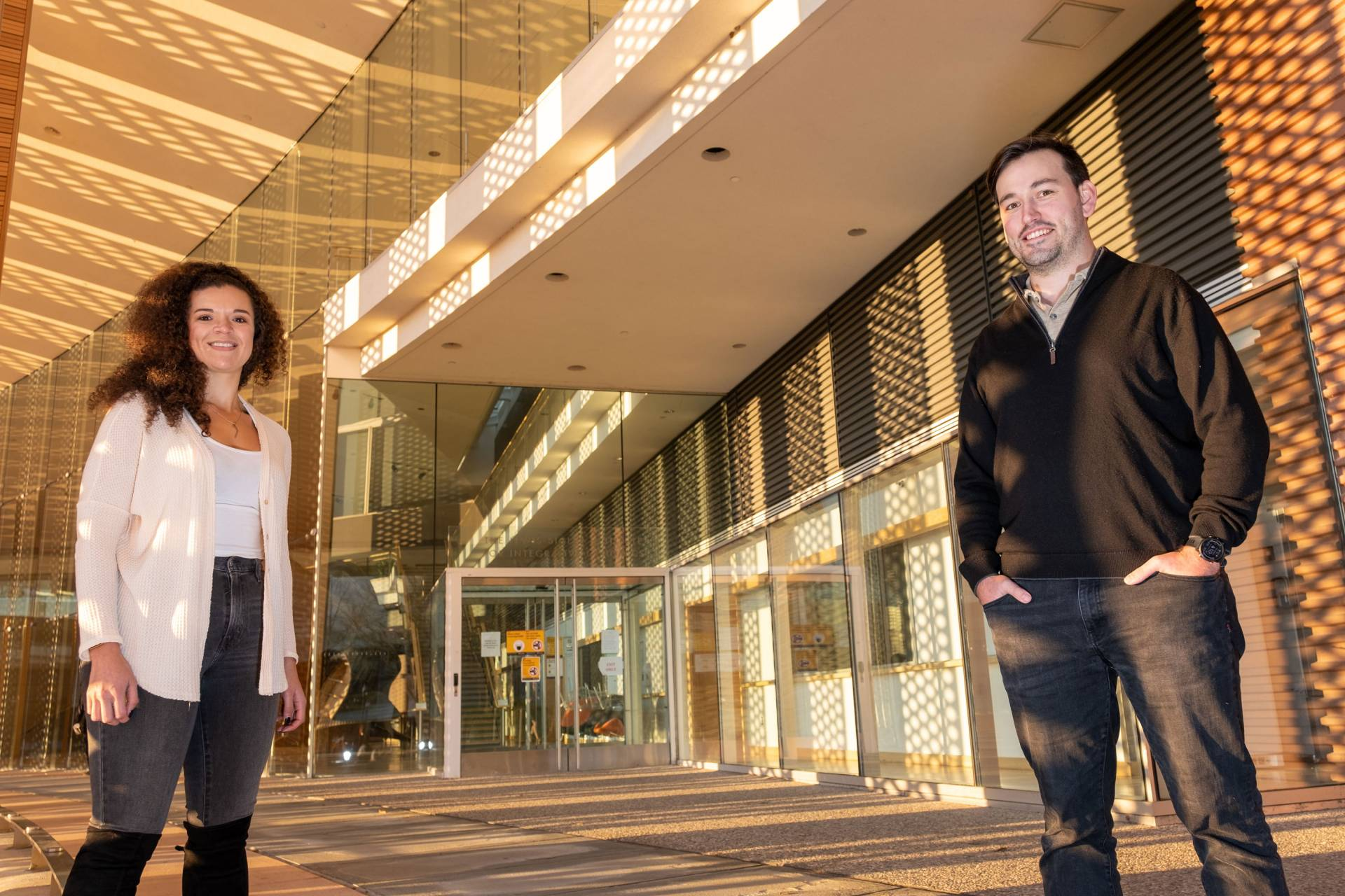 Alexis Cowan and Michael Neinast at the entrance of the Icahn building