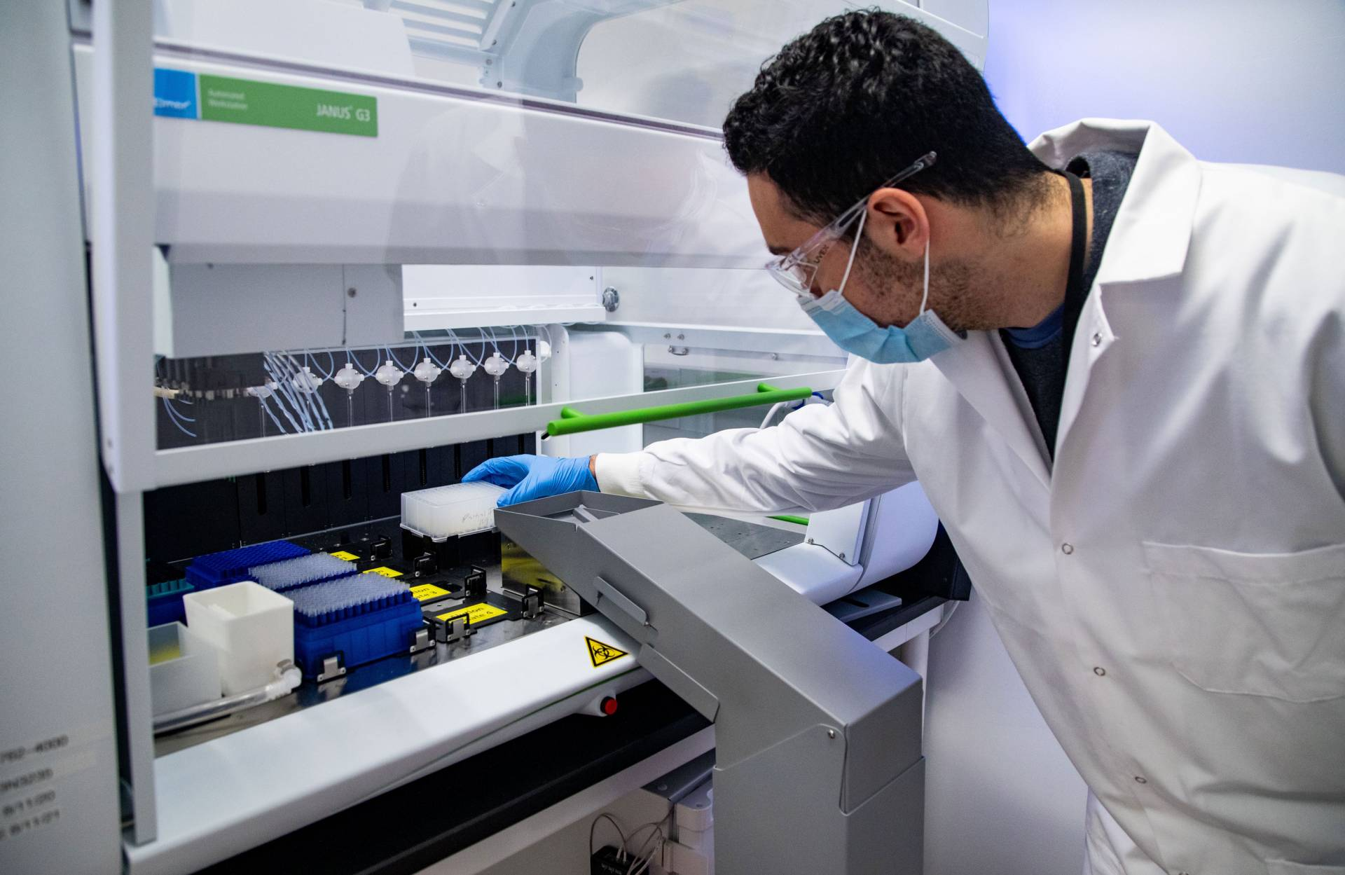 A lab technician handles samples
