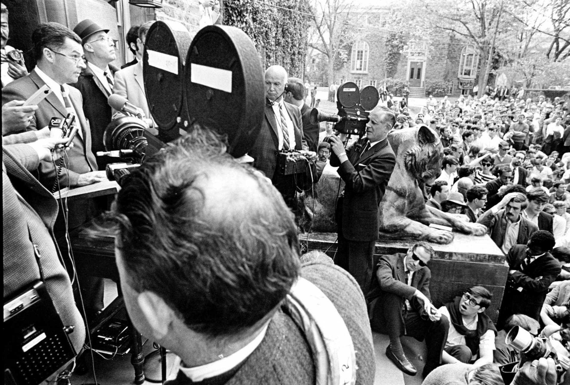 archival photo showing Robert F. Goheen addressing a crowd protesting the Vietnam War